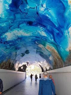 Anthony walking through beautifully painted tunnel