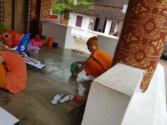 Young Monks getting their paper mache items ready