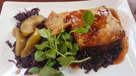 Slow cooked crispy skin pork belly with apples
