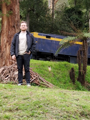Laurence in front of one of the old carriages from Puffing Billy
