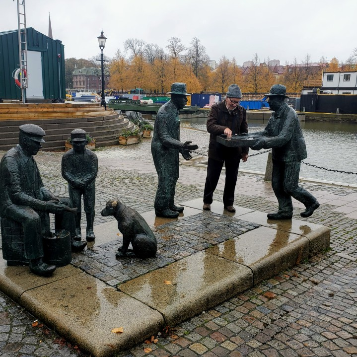 Trying to blend in. I love these statutes of old fisherman